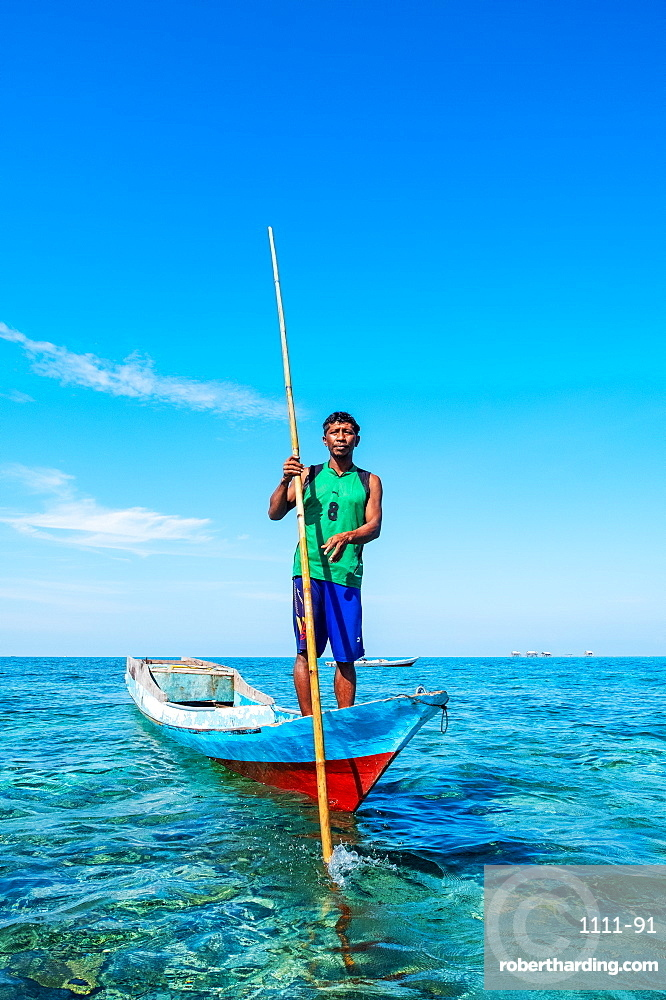Portrait of Bajau fisherman scouring the ocean, Togian Islands, Indonesia, Southeast Asia, Asia