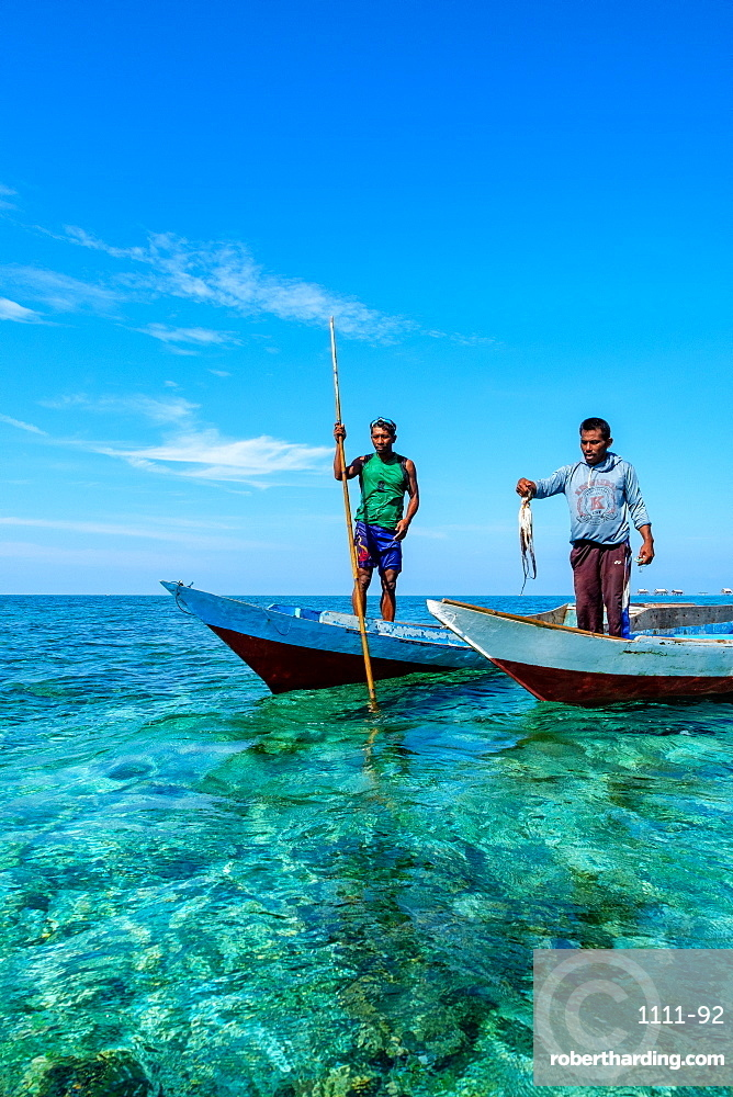 Bajau Fishermen holding an octopus, Togian Islands, Indonesia, Southeast Asia, Asia