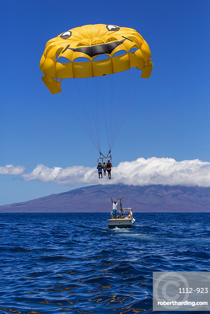 Visitors parasailing in the AuAu Channel, Maui, Hawaii, United States of America, Pacific