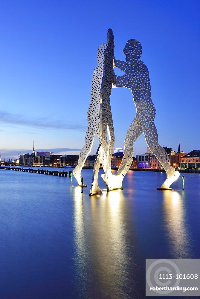 Illuminated artwork Molecule Man above the river Spree, artist Jonathan Borofsky, Berlin, Germany