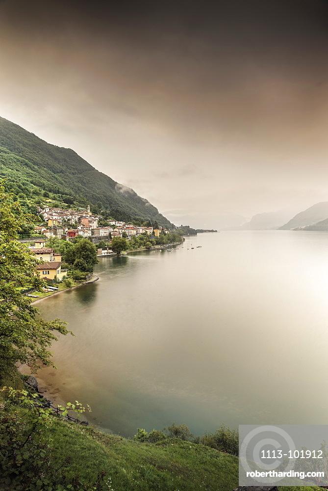 Steep coast with view to Dorio village during rain, Lake Como, Lombardy, Italy, Europe