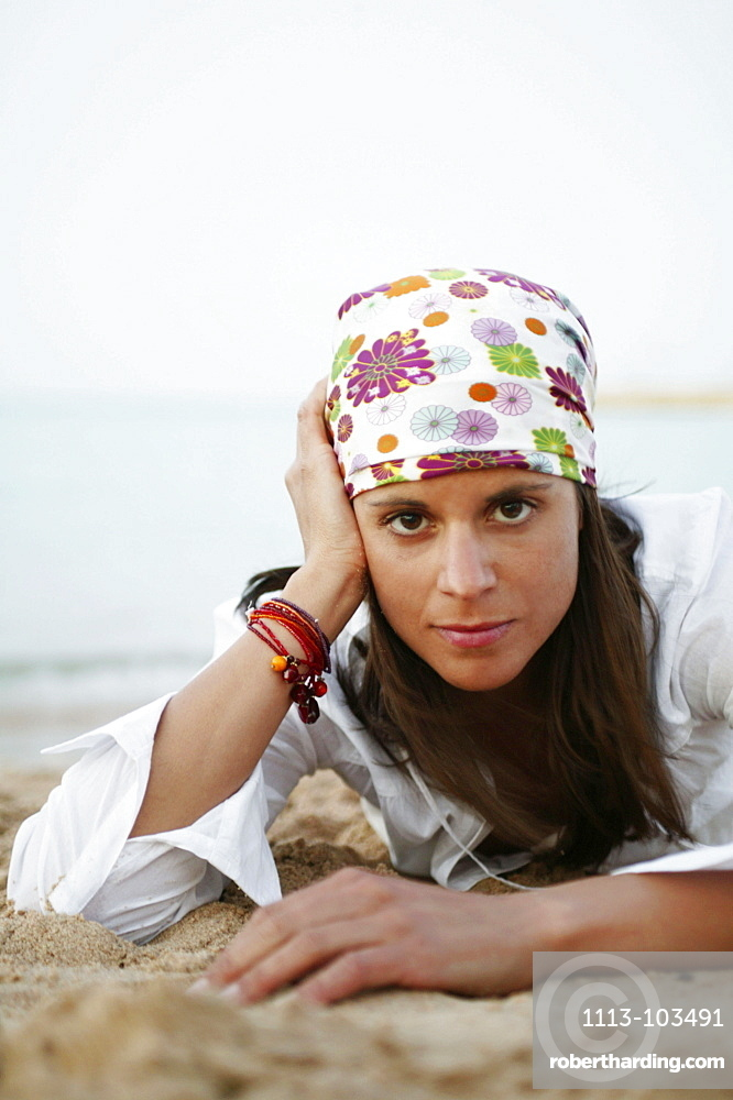 Portrait of young woman with headscarf
