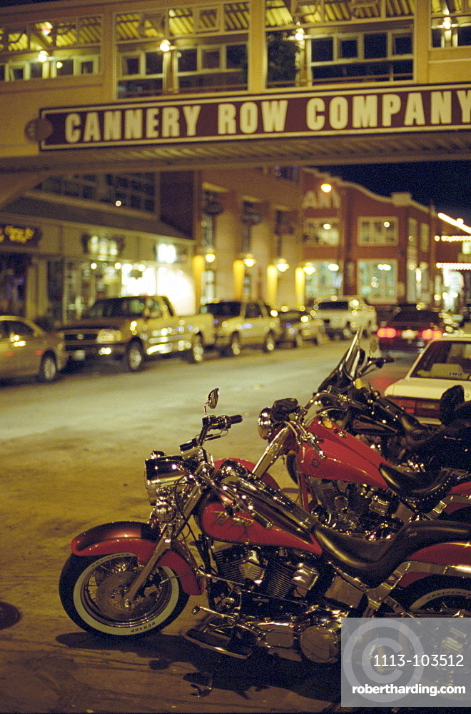 Motor bikes and cars parking at Cannery Road at night, Monterey, California, USA, America