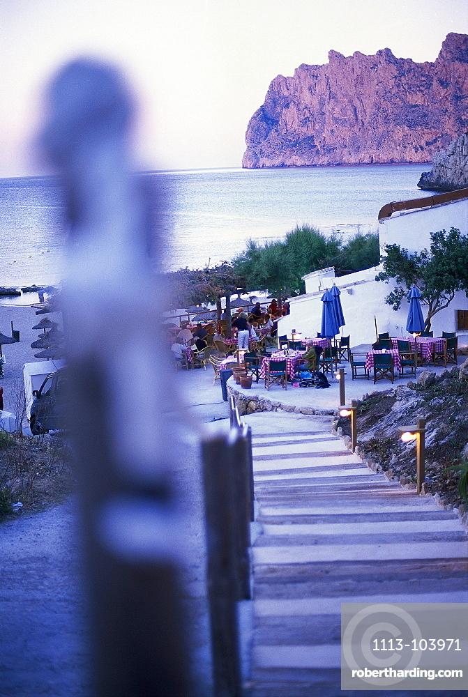 Beach restaurant in the evening light, Cala San Vicente, Majorca, Balearic Islands, Spain