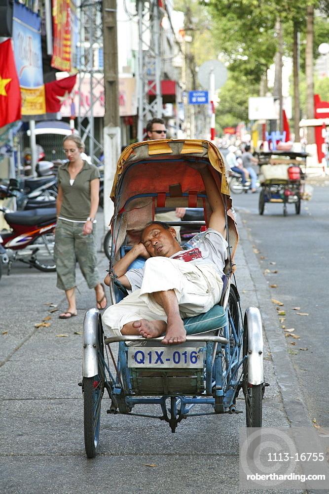 Sleeping man in trishaw, Saigon, Ho Chi Minh City, Vietnam, Asia
