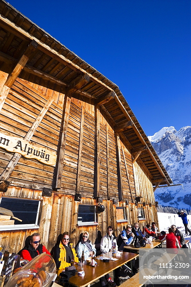 Guests resting on terrace of the chalet Alpwaeg, First, Grindelwald, Bernese Oberland, Canton of Bern, Switzerland