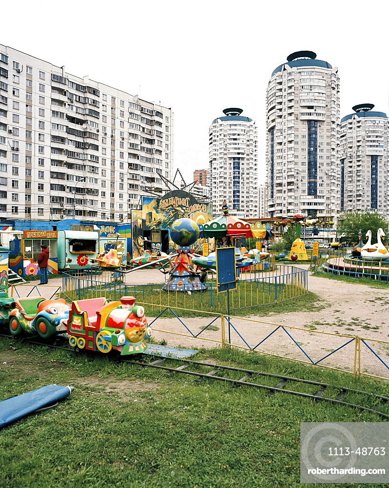 Amusement park amidst high rise buildings at metro station Bratislavskaya, southeastern Moscow, Russia