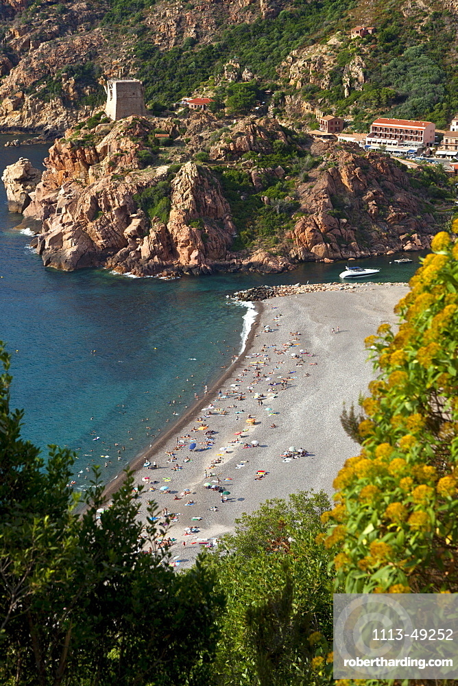 Porto and the beach and the genoese tower in the background, Corsica, France