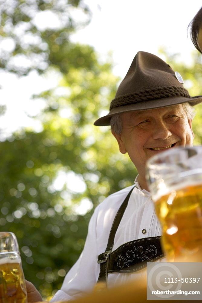Senior man in beergarden near Lake Starnberg, Bavaria, Germany