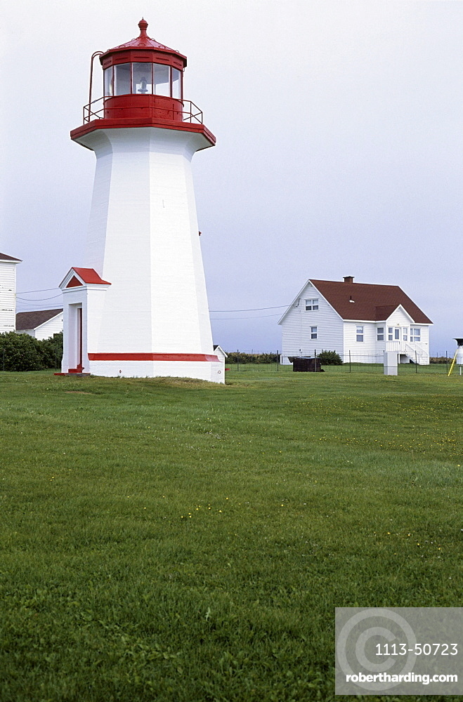 Lighthouse next to houses, Gaspesie, Quebec, Canada