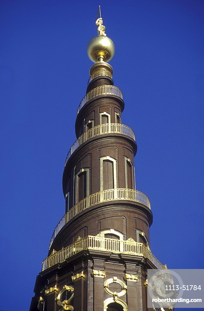 Steeple of Vor Frelser church under blue sky, Copenhagen, Denmark, Europe
