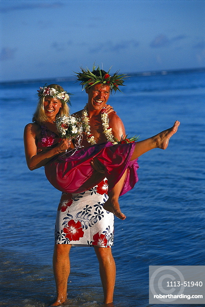 Groom carries bride, South Seas Wedding, Rarotongan Beach Resort, Rarotonga, Cook Islands, South Pacific