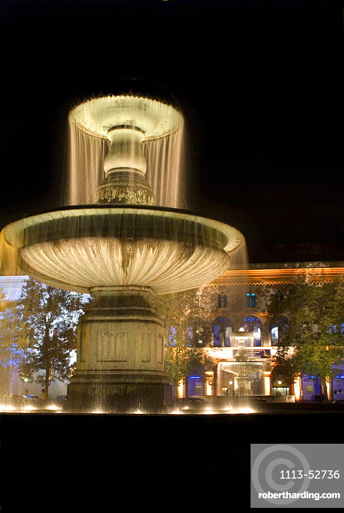 Fountain in front of Munich University at night, Munich, Bavaria, Germany