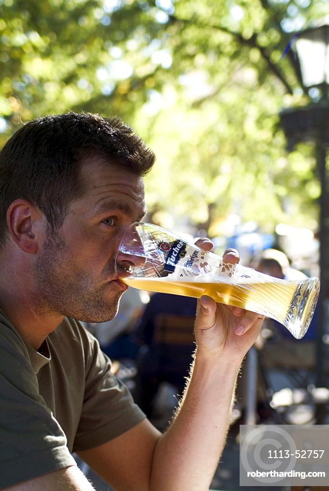 Man drinking Weissbier in Beergarden Hofgarten, Munich, Bavaria, Germany
