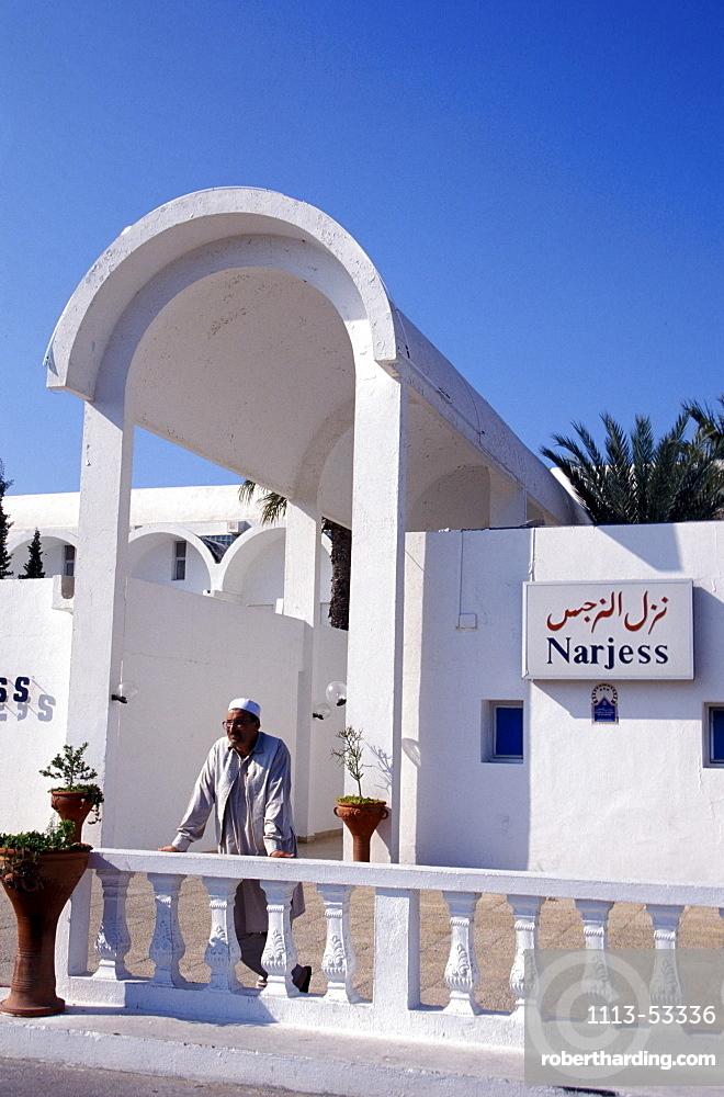 Person in front of the Dar Djerba hotel, Djerba, Tunesia, Africa