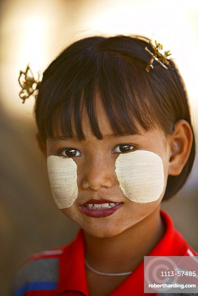 young girl with Tanaka powder as sunscreen, Myanmar