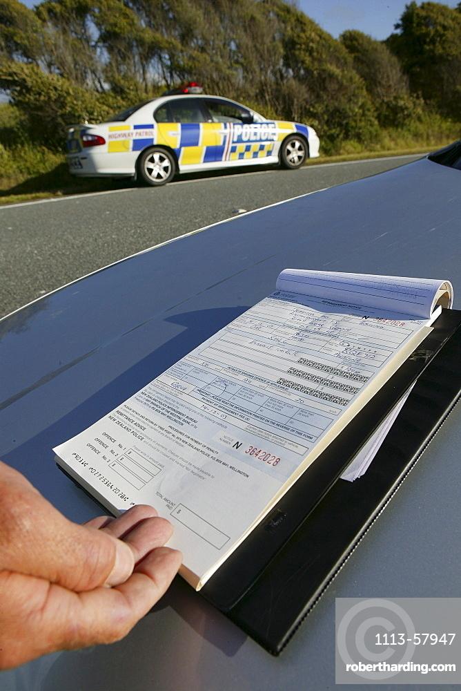 Policeman drawing a speeding ticket, Highway 6, West Coast, South Island, New Zealand, Oceania