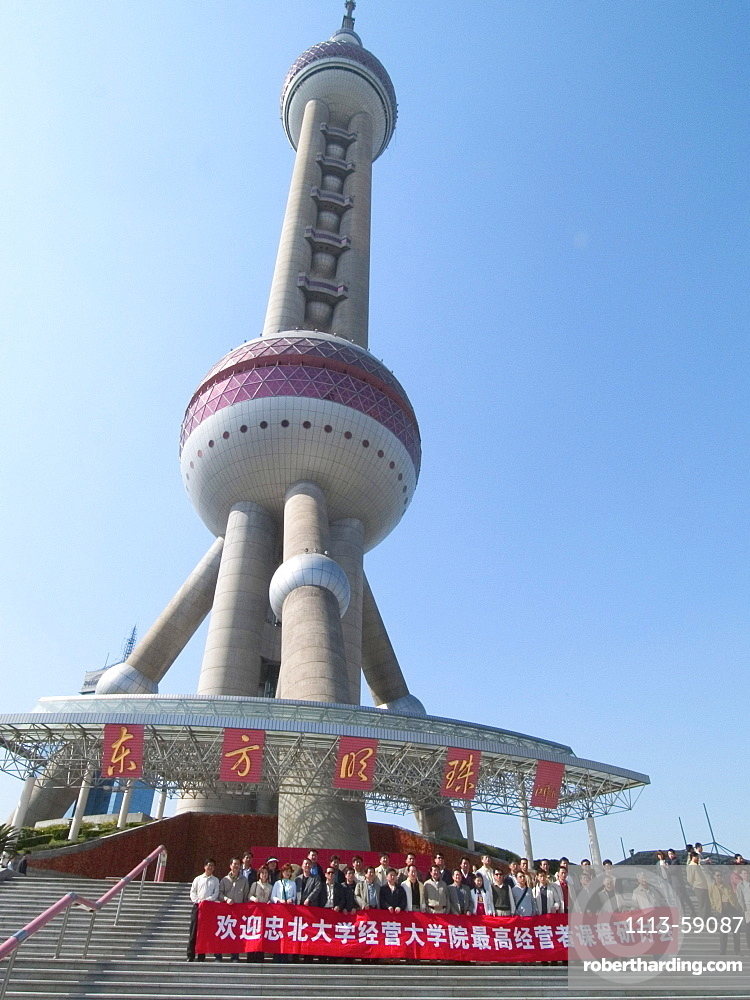 Tourists in front of the Pearltower, 468 m, built by architect Jia Huan Cheng and Shanghai Modern Architectural Design Co. Ltd., Pudong, Shanghai, China, Asia