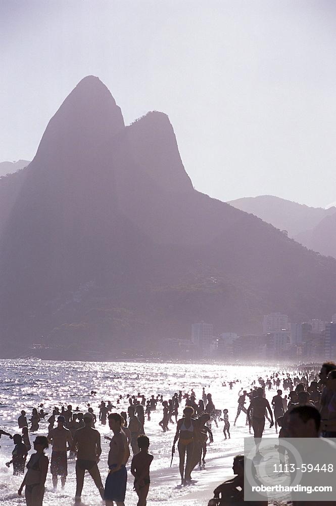 People on Ipanema beach in the sunlight, Morro Dois Irmaos, Rio de Janeiro, Brazil, South America, America