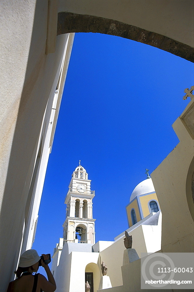 Tourist filming cathedral, Fira, Santorin, Cyclades, Greece, Europe