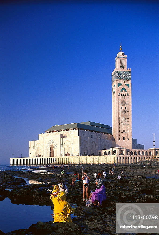 People at the reef and mosque Hassan II under blue sky, Casablanca, Morocco, Africa