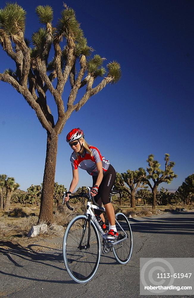 Woman on a racing bike at Joshua Tree National Park, California, USA
