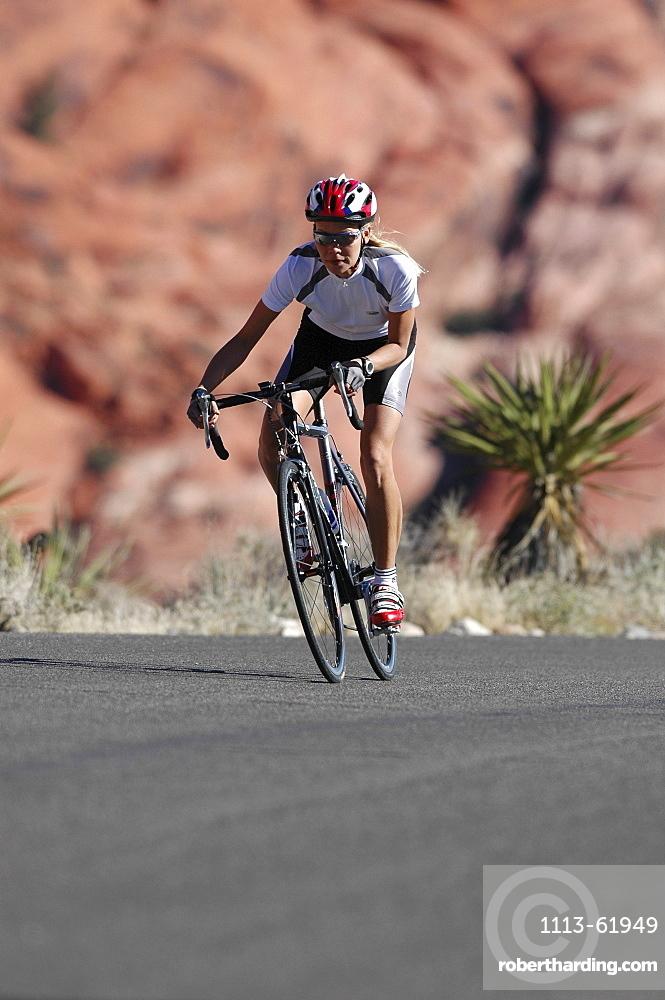 Woman on a racing bike in Zion National Park, Springdale, Utah, USA