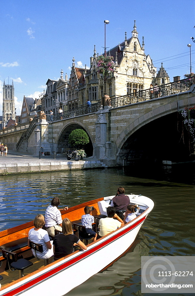 People in a boat and Graslei with St. Michiels bridge, Gent, Flanders, Belgium, Europe