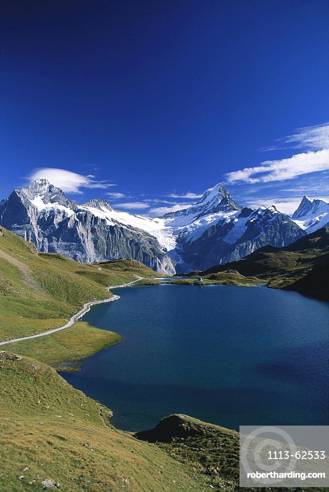 Alpine lake Bachalpsee with Wetterhorn and Schreckhorn, near Grindelwald, Bernese Oberland, Berne, Switzerland