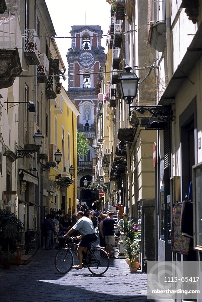Bicyclist crossing alley in Sorrento, Campania, Italy