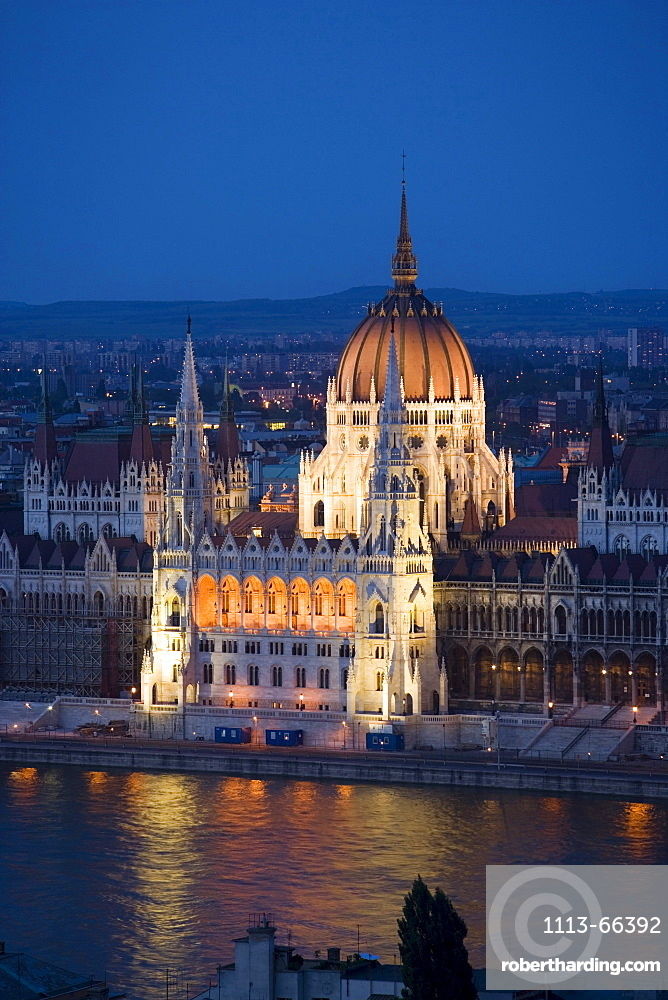 View over the Danube river to the illuminated Parliament at night, Pest, Budapest, Hungary