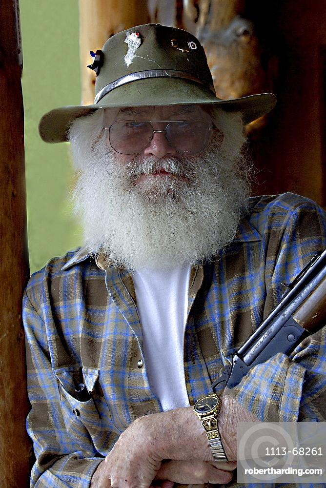 Man with Rifle in Alaska, USA00057231