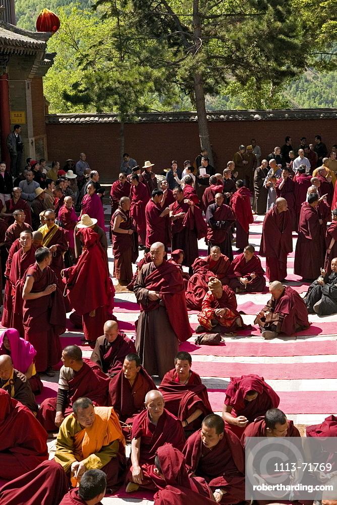 prayer ceremony, buddhist monks, court yard, during birthday of Wenshu, Xiantong Monastery, Wutai Shan, Five Terrace Mountain, Buddhist Centre, town of Taihuai, Shanxi province, China, Asia