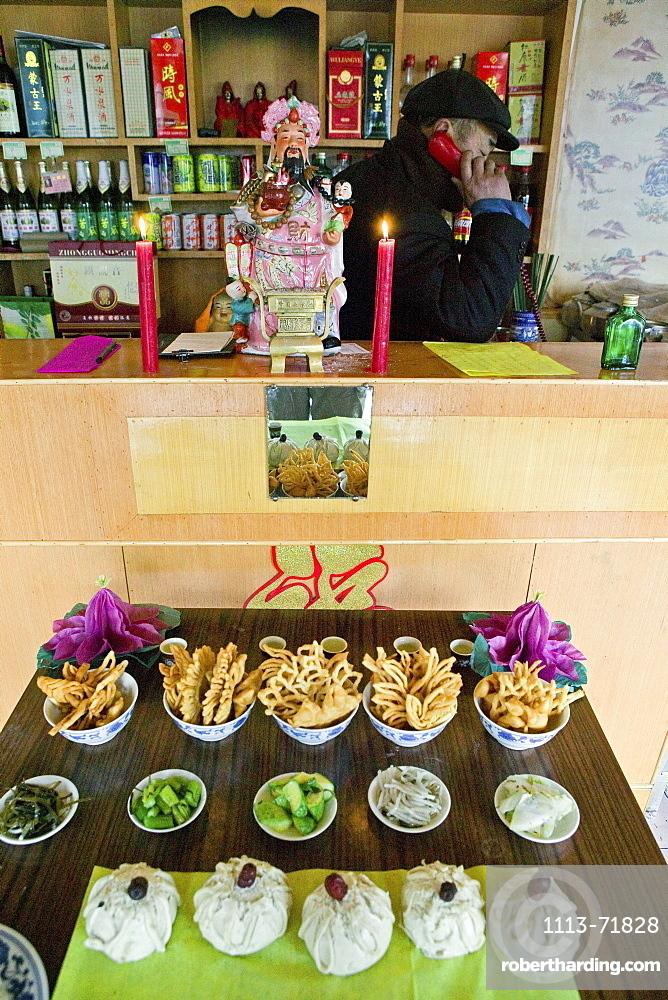Village shop with house shrine, Chinese New Year, Mount Wutai, Wutai Shan, Taihuai, Shanxi province, China