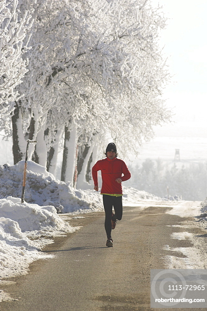 Male jogger in winter, Upper Austria