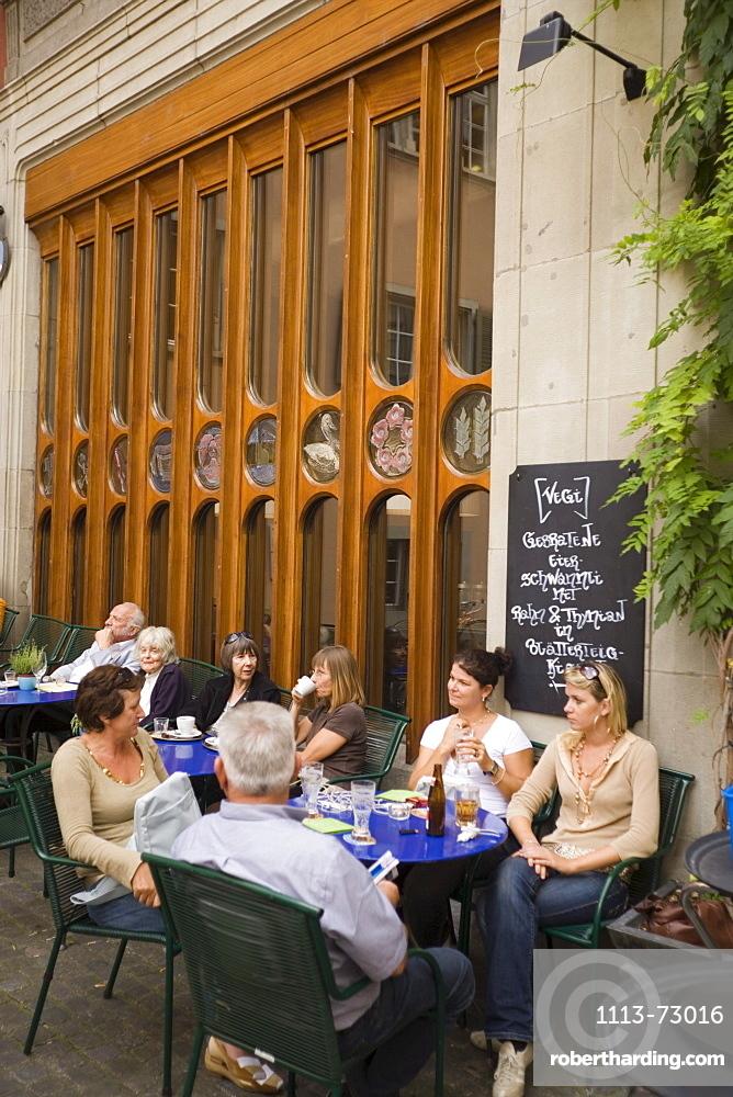Guest sitting in a pavement cafe, Neumarkt, Zurich, Canton Zurich, Switzerland