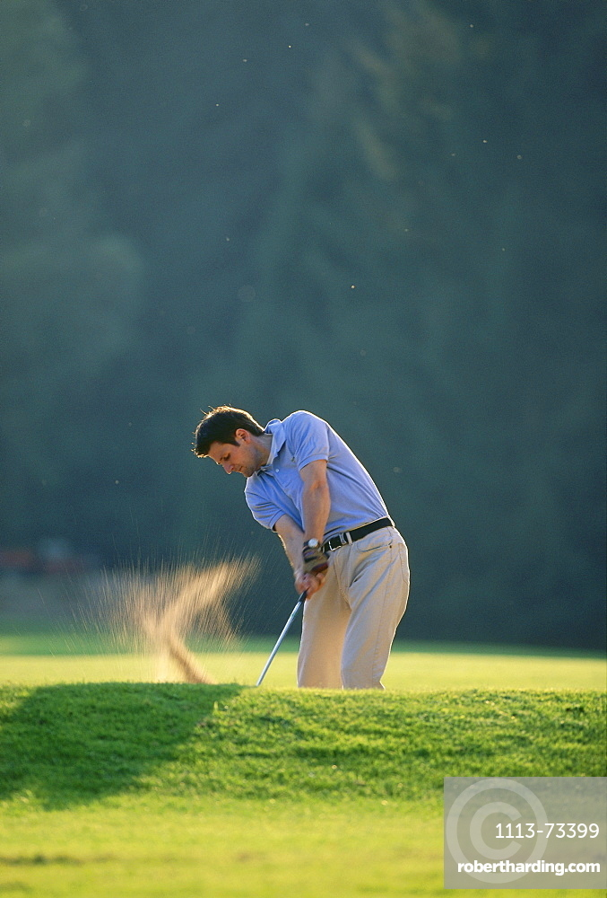 Man playing golf, Munich Golf Club, Strasslach, Munich, Bavaria, Germany, Europe