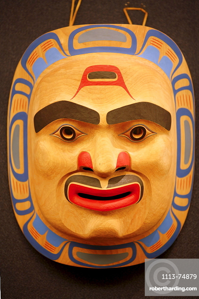 A carving of a face, mask inside the National Museum of the American Indian, Washington DC, United States USA