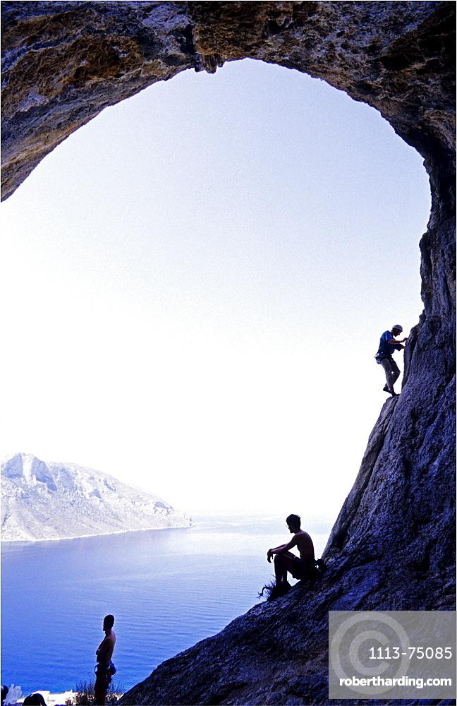 Kalymnos, Greece, three climbers in a cave above the sea, Aegean Sea, Europe