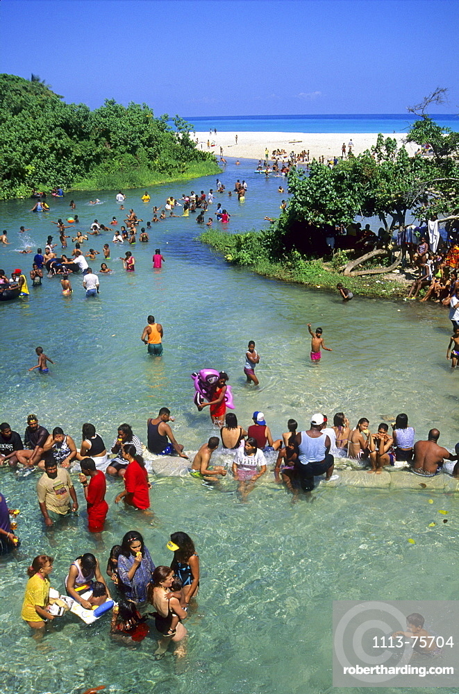 People enjoying the cool water of Rio Nizaito close to the village of Paraiso in the southwestern district of Barahona in Dominican Republic, Caribbean