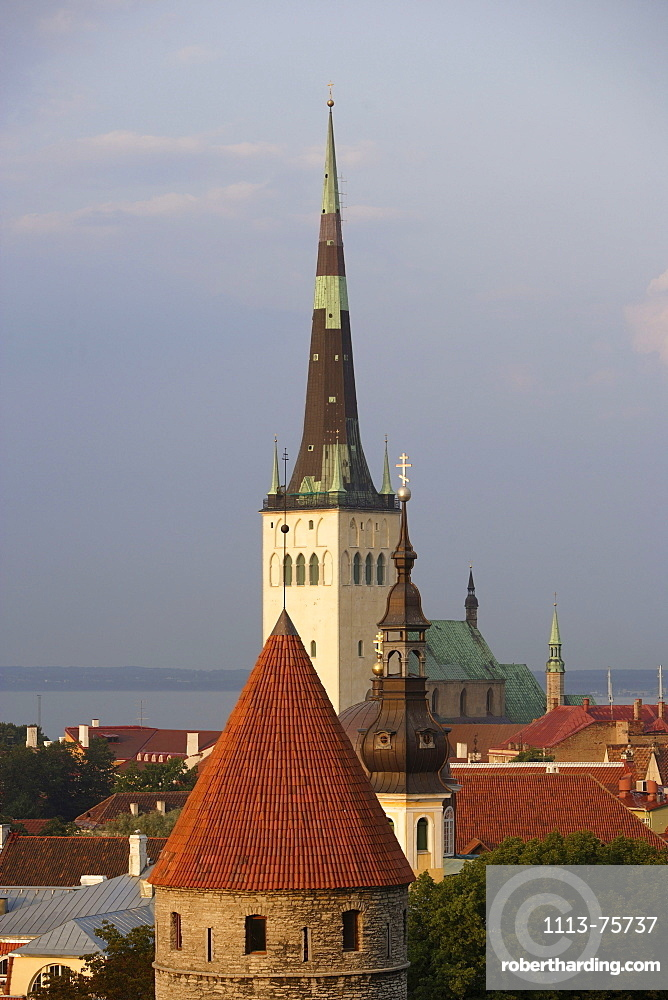 View over the old town of Tallinn seen from Rohukohtu terrace. One of the tower of the city walls in the front, St. Michael's monastery and St. Olaf's Church in the back, Tallinn, Estonia