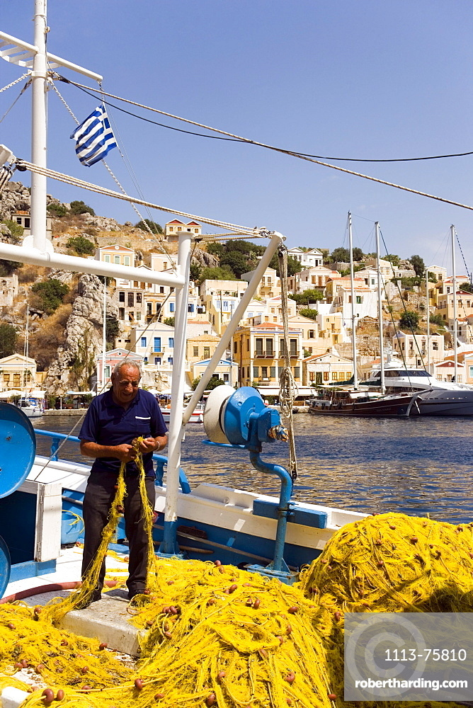 Fisherman sorting yellow flue, Simi, Symi Island, Greece