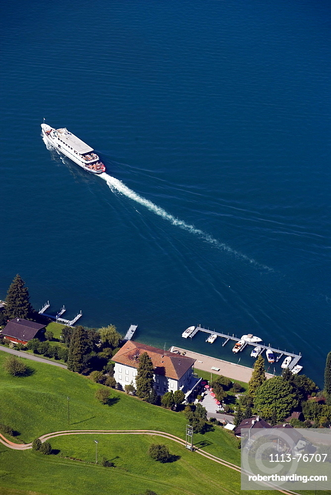 View from mountain Buergenstock (1128 m) to Lake Lucerne with excursion boat, ship station Kehrsiten, Lucerne, Canton Lucerne, Switzerland