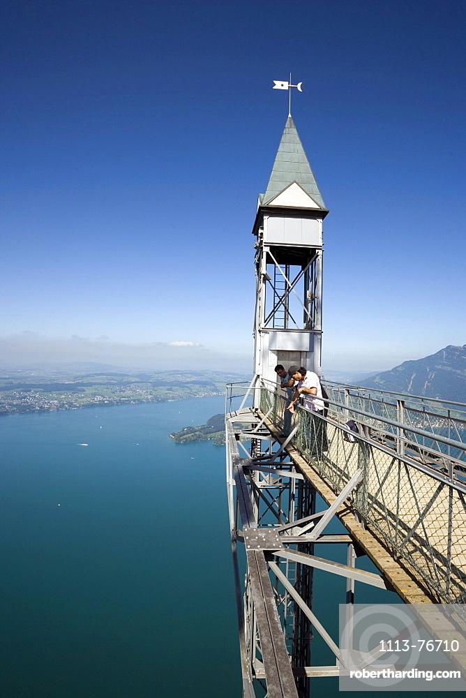 People standing on platform of Hammetschwand Elevator (153 m, highest exterior elevator of Europe) and looking down, Buergenstock (1128 m), Buergenstock, Canton Nidwalden, Switzerland