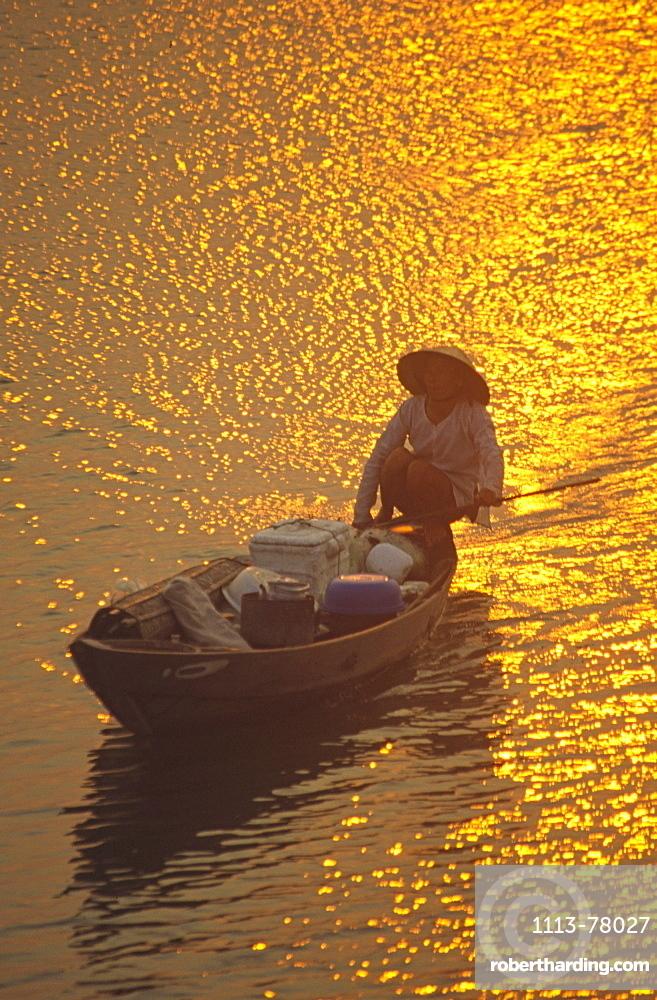 Fishing boat at sunset, rivers delta, Nha Thrang, Vietnam