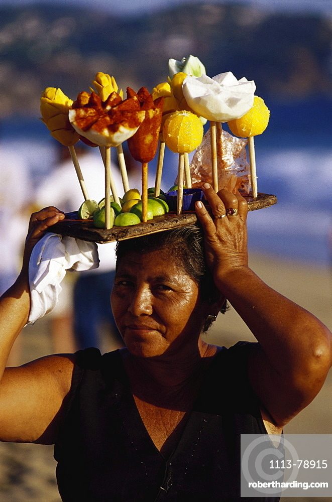 Woman carrying fruits with chilli, Mexico, America
