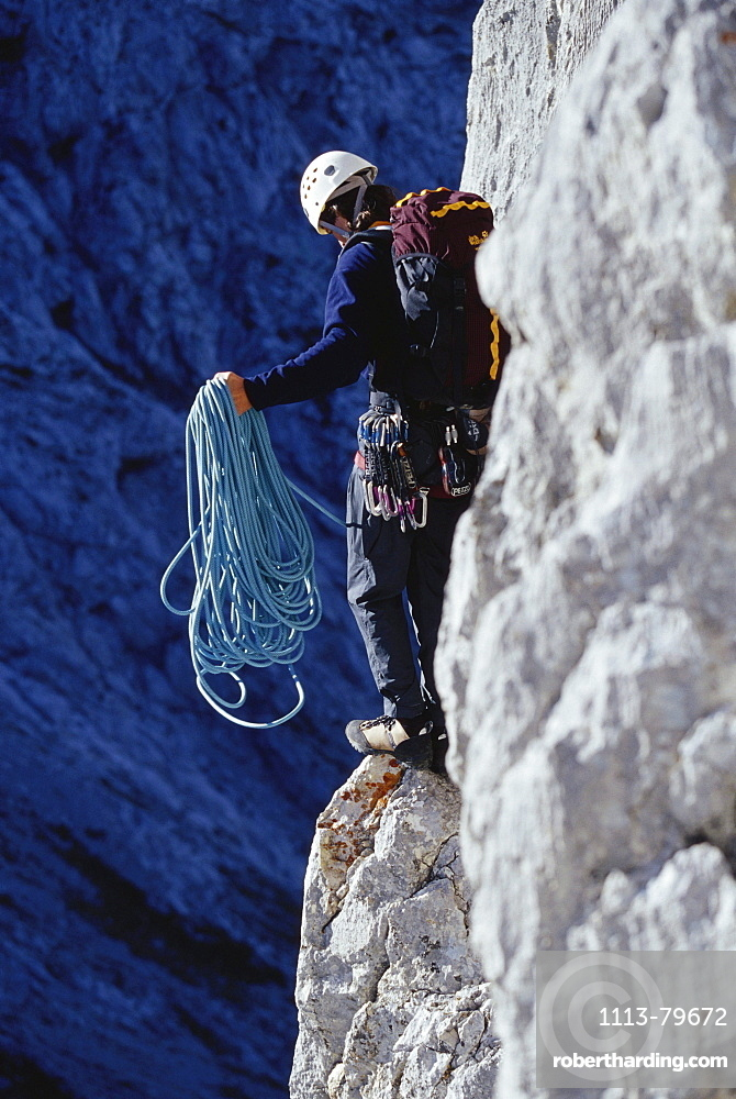 Man about to abseil, abseiling, Climbing rope, Alpine Climbing, Sport, Mountain, Wetterstein, Bavarian Alps, Bavaria, Germany