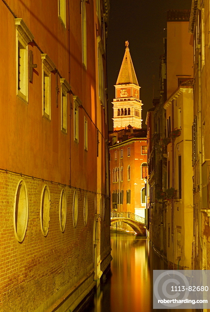 Canal between houses, bridge and spire at night shot, Venice, Venezia, Italy