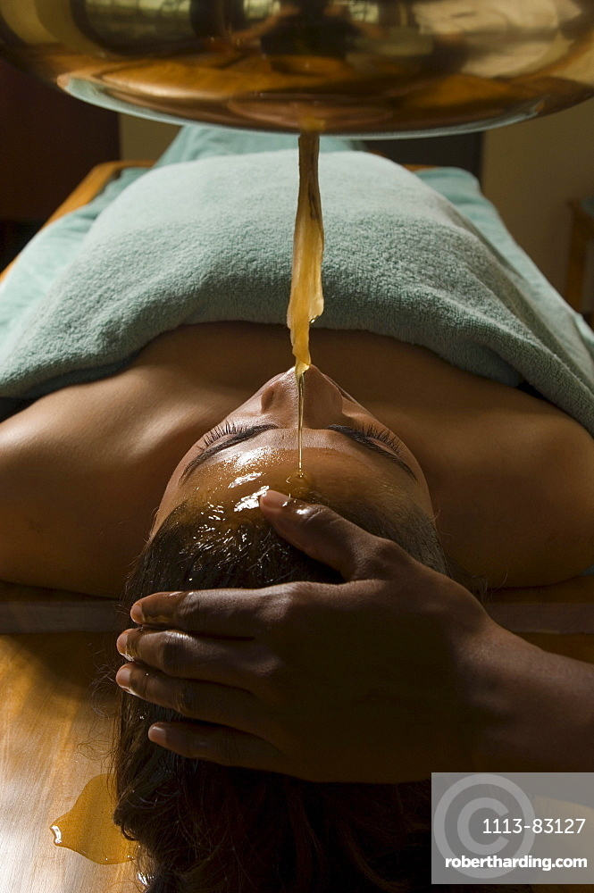 Woman receiving an Ayurveda oil therapy, Ayurvedic massage treatment, Shanti Ananda Resort und Spa, Mauritius