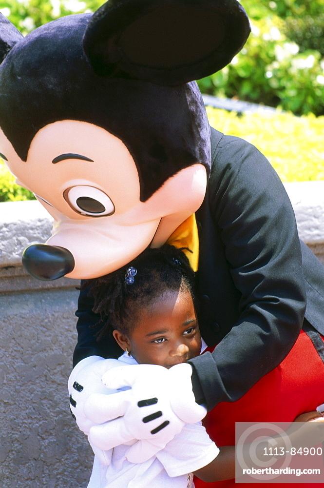 Mickey Mouse with child, Disneyworld, Orlando, Florida, USA